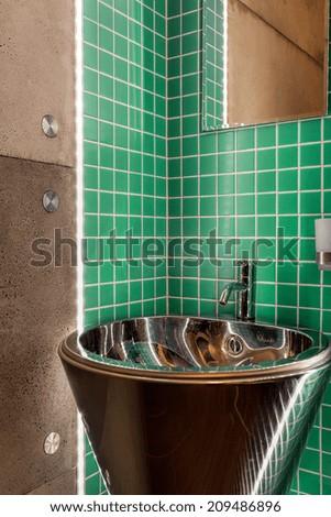 Sink in a modern green bathroom, vertical - stock photo