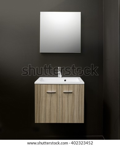 Sink vanity with furniture  on Brown wall - stock photo