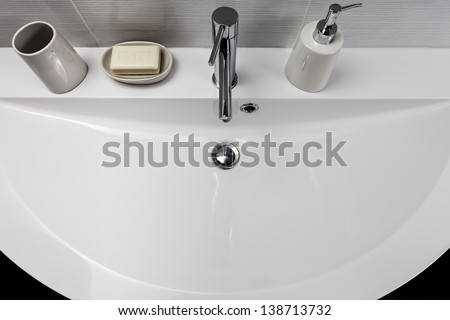 sink with soap dish and soap dispenser on his shelf - stock photo