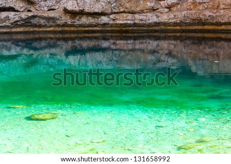 Sinkhole with emerald green water at Hawiyat Najm Park, Oman - stock photo