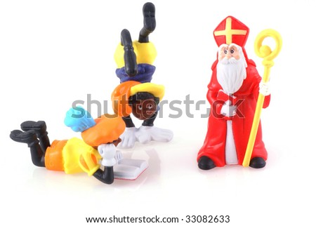 Sinterklaas and black pieten, characters from a traditional dutch holiday; isolated on white. - stock photo