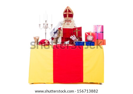 SInterklaas is working at his desk, on a white background - stock photo