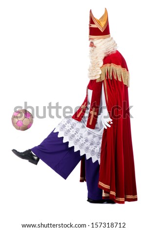 Sinterklaas playing soccer, on a white background - stock photo