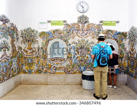 SINTRA - NOVEMBER 09, 2015: Typical wall decoration of ceramic tiles (azulejos) at train station in Sintra, near Lisboan (Portugal) - stock photo