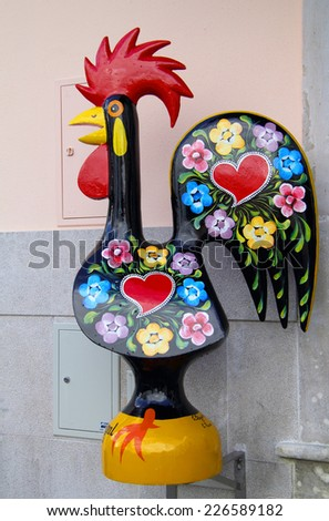SINTRA, PORTUGAL - JANUARY 20, 2014: A large display version of the typical  Barcelos Rooster or Galo de Barcelos, which originates from an old fairytale. On January 20, 2014 in Sintra, Portugal  - stock photo