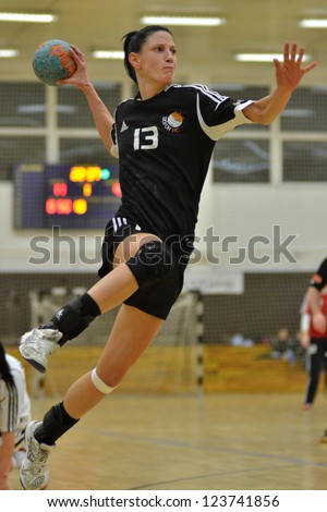 SIOFOK, HUNGARY - JANUARY 5: Babett Szalai (black 13) in action at a Hungarian National Championship handball match Siofok KC (black) vs. Budapest SE (white) January 5, 2013 in Siofok, Hungary. - stock photo