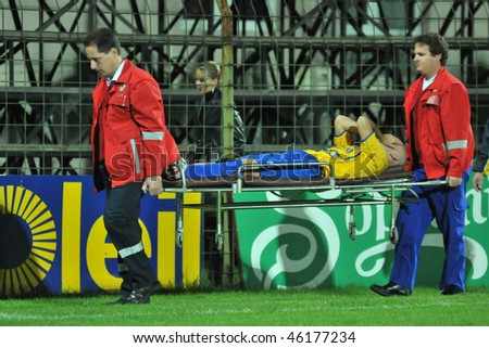 SIOFOK, HUNGARY - OCTOBER 3: Two ambulance men carry the player at a Hungarian National Championship soccer game Siofok vs. Budapest Honved October 3, 2008 in Siofok, Hungary. - stock photo