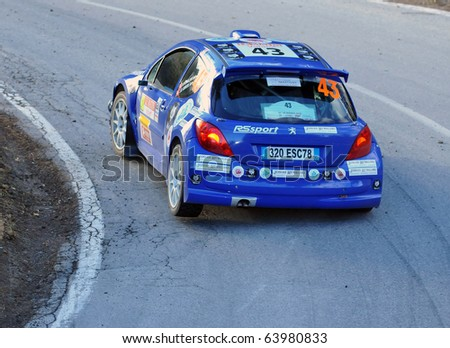 SION, SWITZERLAND - OCTOBER 28: Josias Rywalski on Day 1, Stage 1 of the International Rally of the Valais in a Peugeot 207: October 28, 2010 in Sion Switzerland