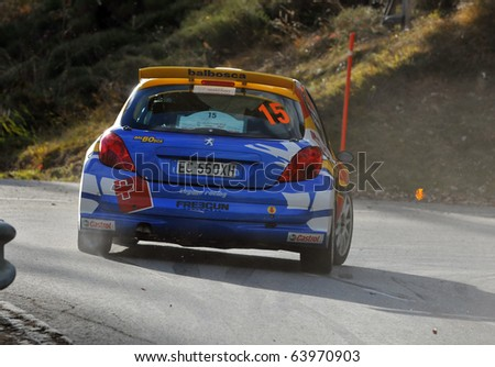 SION, SWITZERLAND - OCTOBER 28: Perroud and Pallone on Day 1, Stage 1 of the International Rally of the Valais in a Peugeot 207 on October 28, 2010 in Sion Switzerland