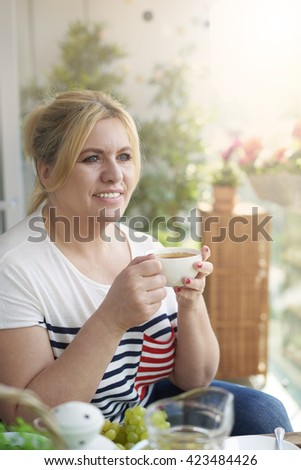 Sip of coffee on the balcony - stock photo