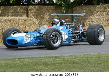 Sir Jackie Stewart in historic Matra Formula 1 Grand Prix car at Goodwood Festival of Speed