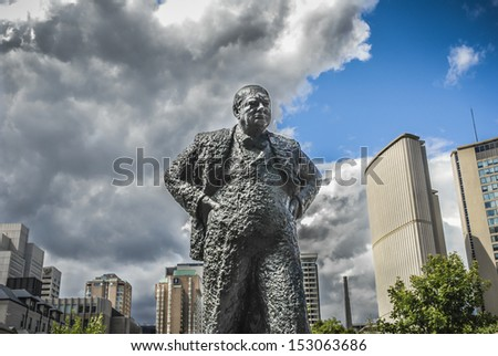 Sir Winston Churchill Memorial in Toronto, Canada with dramatic sky behind symbolic of coming out of dark times into blue skies.. - stock photo