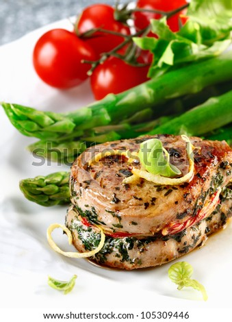Sirloin steak of a pork and asparagus and some tomatoes. Fresh red meat meal menu - stock photo