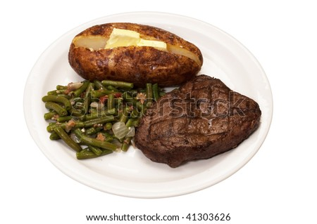 Sirloin steak with baked potato and green beans isolated on white background with clipping path.