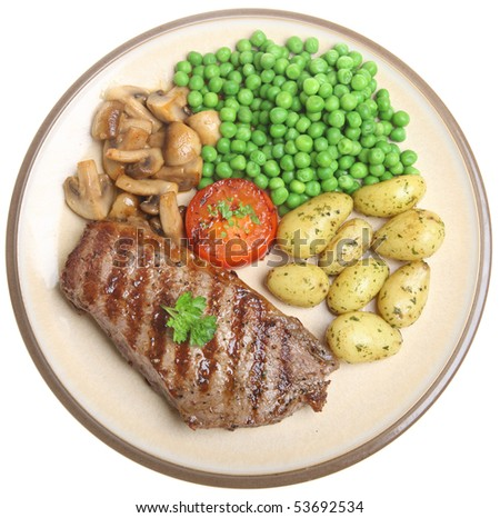 Sirloin steak with new potatoes, peas and mushrooms. - stock photo