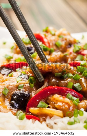Sirloins on sweet and sour sauce served with boiled rice