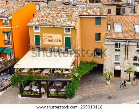 SIRMIONE, ITALY - JUNE 26, 2014: Beautiful panoramic view of the Sirmione town, Italy. Sirmione became popular touristic destination on the Lake garda, the largest lake in Italy