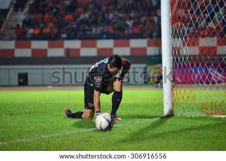 SISAKET THAILAND-AUGUST 12: Sinthaweechai (GK) of Chonburi FC. in action during Chang FA Cup between Sisaket FC and Chonburi FC at Sri Nakhon Lamduan Stadium on August 12,2015,Thailand - stock photo