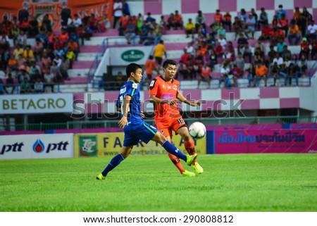 SISAKET THAILAND-JUNE 21: Teerachai Ngamcharoen (orange) of Sisaket FC. in action during  Thai Premier League between Sisaket FC and Navy FC at Sri Nakhon Lamduan Stadium on June 21,2015,Thailand - stock photo