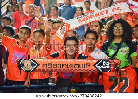 SISAKET THAILAND-MARCH 7: Sisaket FC Fans cheer during Thai Premier League between Sisaket FC and Gulf Saraburi FC at Sri Nakhon Lamduan Stadium on March 7,2015,Thailand - stock photo