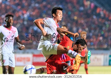 SISAKET THAILAND-MARCH 7: Yutthapong Srilakorn of Saraburi FC (white) head the ball during Thai Premier League between Sisaket FC and Saraburi FC at Sri Nakhon Lamduan Stadium on March 7,2015,Thailand
