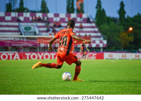 SISAKET THAILAND-MAY 3: Durosinmi Gafar (orange) of Sisaket FC. in action during Thai Premier League between Sisaket FC and Chiang rai united at Sri Nakhon Lamduan Stadium on May 3,2015,Thailand - stock photo
