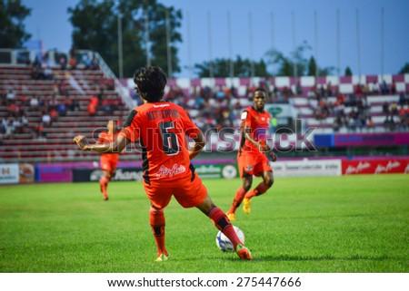 SISAKET THAILAND-MAY 3: Kittipong Rongruk (orange no.6) of Sisaket FC. in action during Thai Premier League between Sisaket FC and Chiang rai Utd. at Sri Nakhon Lamduan Stadium on May 3,2015,Thailand - stock photo