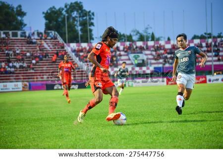 SISAKET THAILAND-MAY 3: Kittipong Rongruk (orange) of Sisaket FC. in action during Thai Premier League between Sisaket FC and Chiang rai united at Sri Nakhon Lamduan Stadium on May 3,2015,Thailand - stock photo