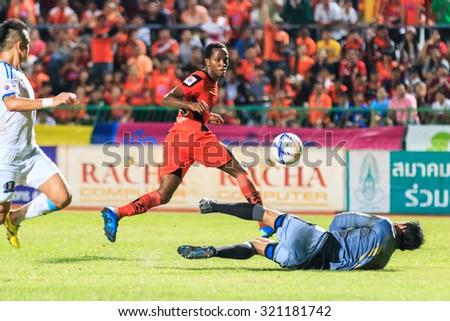 SISAKET THAILAND-SEPTEMBER 20: Adefolarin Durosinmi of Sisaket FC. shooting ball during Thai Premier League between Sisaket FC and TOT SC at Sri Nakhon Lamduan Stadium on September 20,2015,Thailand - stock photo