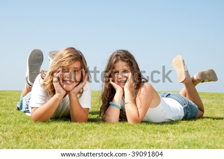Sister and brother on relaxing and smiling - stock photo