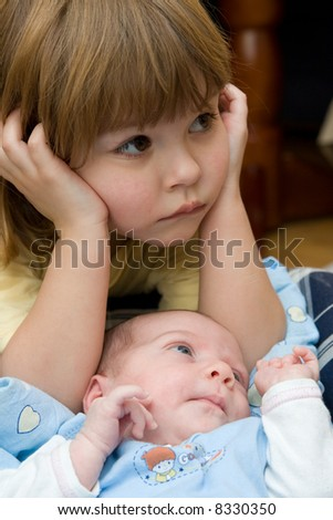 sister and her little, newborn brother - stock photo