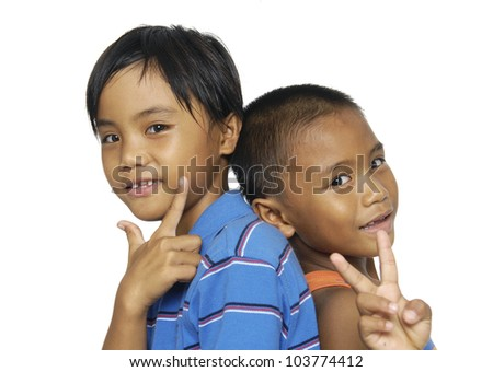 Sister and  Little Brother back to back showing two fingers on each hand