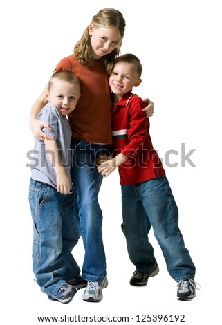 Sister embracing two little brothers - stock photo