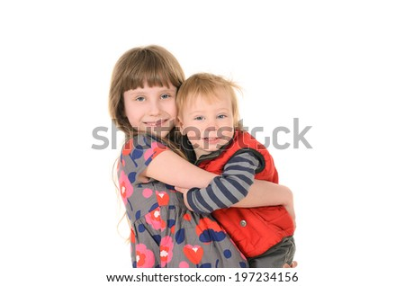 Sister hugging brother, isolated on white background