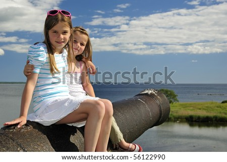 Sister's  summer vacation portrait - stock photo