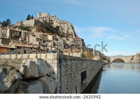 Sisteron is a village situated on the banks of the River Durance, in south of France. The town has several important buildings including the citadelle and 12th century cathedral. - stock photo