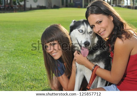 sisters and her faithful husky - stock photo
