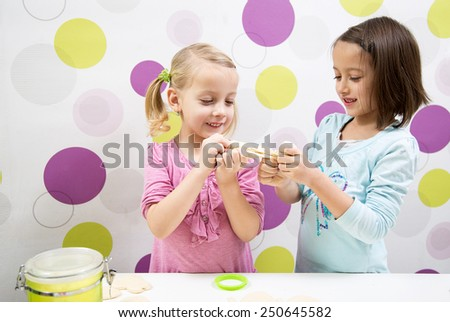 Sisters have fun in kitchen - stock photo