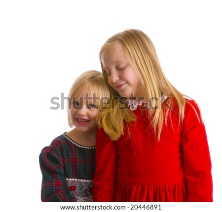 Sisters in Christmas dresses ready for a formal holiday occasion - stock photo
