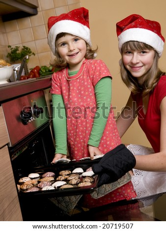 Sisters making christmas cookies - stock photo