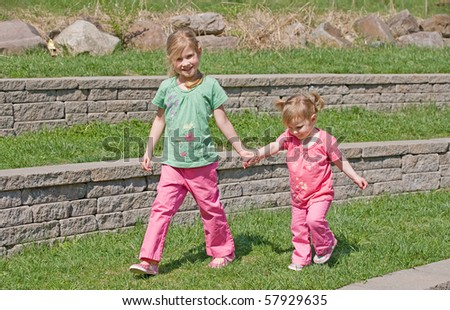 Sisters Walking in the Park - stock photo