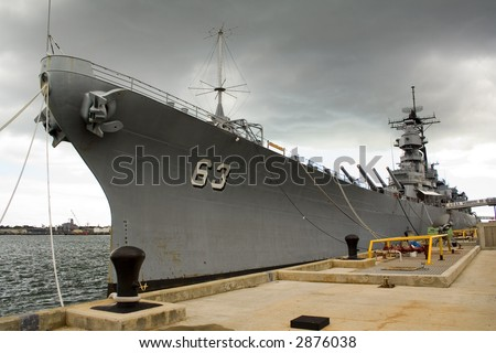 Site of the treaty signing ending WWII between the US and Japan, is now berthed in Pearl Harbor Hawaii. Open to the public this battleship has seen combat in WWII, Korea, Vietnam, and Desert Storm. - stock photo
