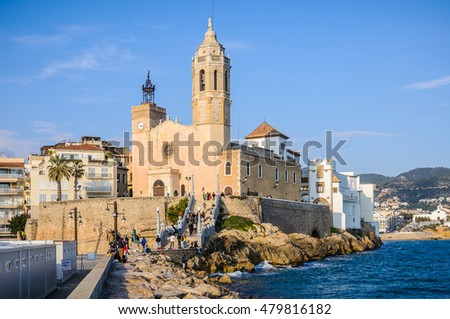 SITGES, SPAIN - MARCH 15, 2015: The view of Sant Bartomeu Church in the picturesque seaside village of Sitges, Catalonia, Spain