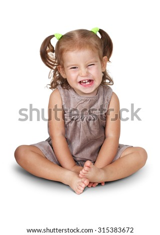 Sitting angry child girl with grin isolated on white - stock photo