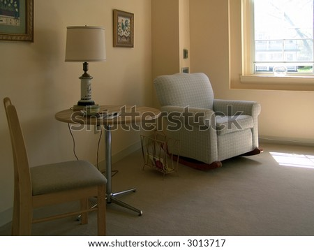 sitting area in assisted living apartment, muted tones, living room, muted tones - stock photo