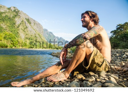 sitting at river - stock photo