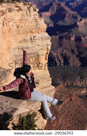 Sitting at the edge of Grand Canyon - stock photo