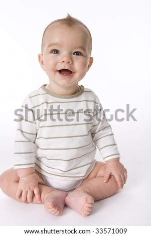 Sitting baby boy with a happy expression - stock photo