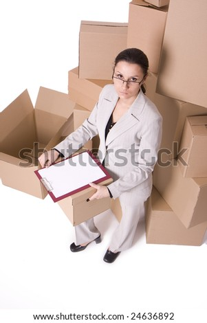 sitting businesswoman in glasses with clipboard and carton boxes
