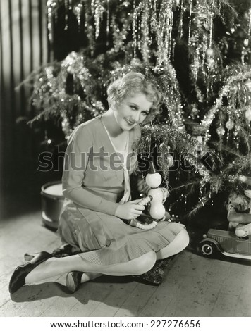Sitting by the Christmas tree - stock photo
